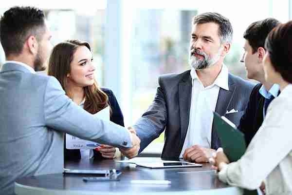 business management consulting firms people shaking hands